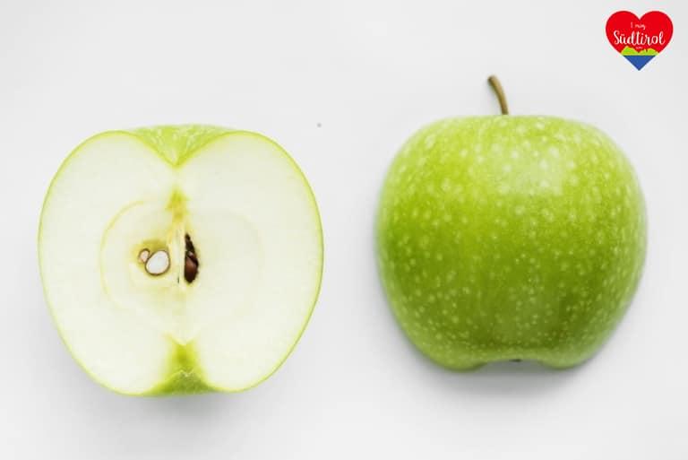 macro-shot-green-apple-isolated-white-background